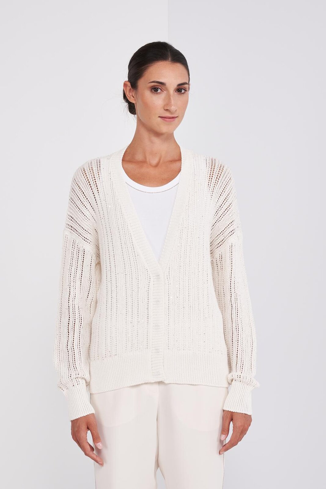 100% Soft Cotton Long Sleeve Tricot Cardigan Sweater. Processing With Micro Sequins Inserted In The Weft, V-neck, Central Button Closure. Regular fit. - Peserico